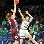 Montana guard McCalle Feller (5) passes over Notre Dame guard Michaela Mabrey (23) in the first half of an NCAA tournament college basketball first round game March 20 in South Bend, Ind.