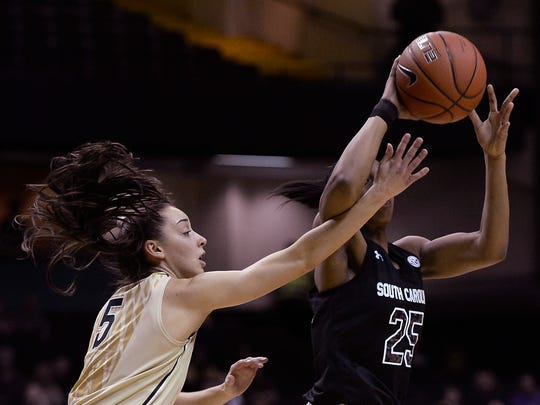 York Catholic graduate Kady Schrann (5) defends against South Carolina guard Tiffany Mitchell (25) during the 2013-14 season. Schrann transferred from Vanderbilt after the 2013-14 season, and she returned to the court for her final college season at Florida Gulf Coast University.