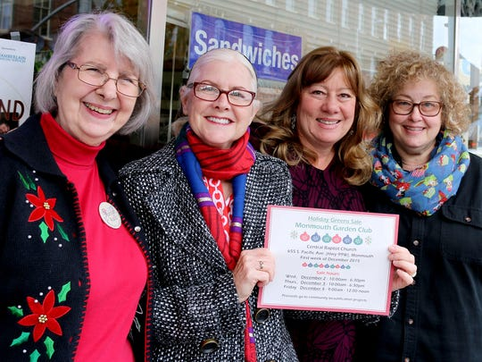 Marilyn Wallis, from left, Ruth Firestone, Jane Gragg and Bonnie Shonholtz, of the Monmouth Garden Club, stand shoulder to shoulder in their quest to drive traffic to their annual Holiday Greens Sale.