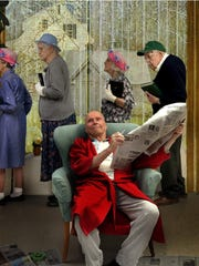 """Parkwood Heights' """"Salute to the Saturday Evening Post"""" calendar includes this humorous photograph for April, in which Parkwood residents recreate Norman Rockwell's """"Sunday Morning."""" Pictured (standing) are Grace Smith, Maxine Pankratz, Jane Bradley and Phil Leete, and (seated) Bruce Pankratz."""