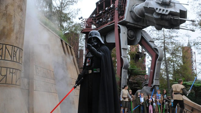 A menacing Darth Vader uses the dark side of the Force to silence a defiant crowd at Disney's Hollywood Studios.