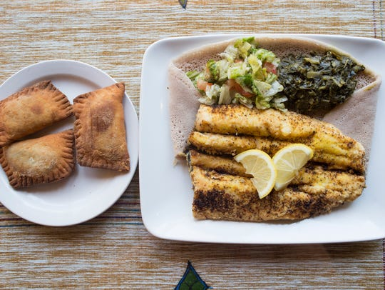 Asa Tibs, a trout dish with collard greens, is served