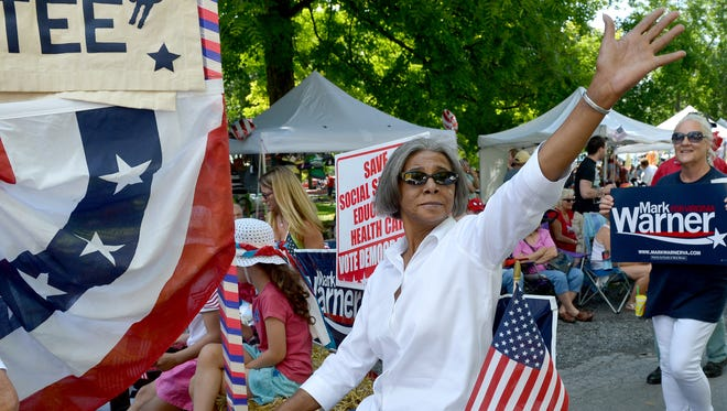 Barbara Lee waves to the crowd as she rides the Augusta County Democratic Committee float during the Fourth of July parade in 2013.