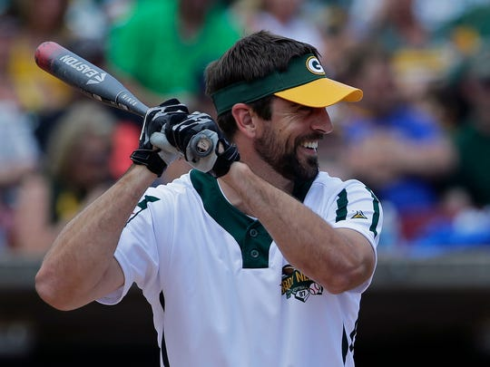 Don't worry, folks, the big guy will be there: Aaron Rodgers will again take the field for the Green & Gold Charity Softball Game this weekend in Grand Chute.