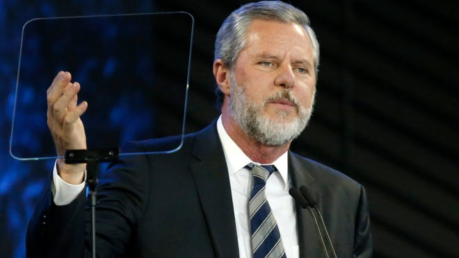 Liberty University President Jerry Falwell Jr. speaks before a November 2018 convocation at the university in Lynchburg, Va. Falwell took an indefinite leave of absence Friday as the leader of Liberty University, days after apologizing for a social media post that caused an uproar even among fellow conservatives.[Steve Helber, The Associated Press (FILE)]