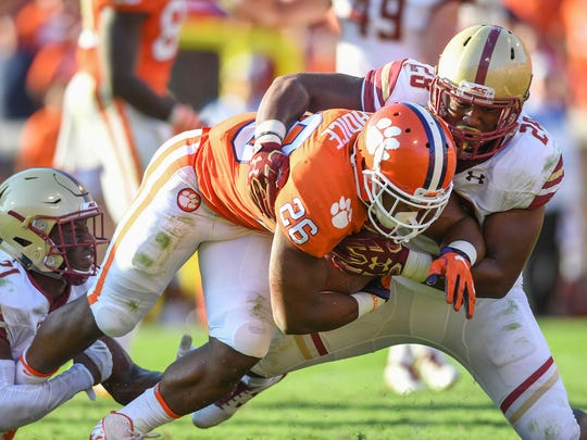 Boston College defensive back Lukas Denis (21), left, and  linebacker John Lamot (28) can't keep Clemson running back Adam Choice (26) out of the end zone during the 4th quarter on Saturday, September 23, 2017 at Clemson's Memorial Stadium.
