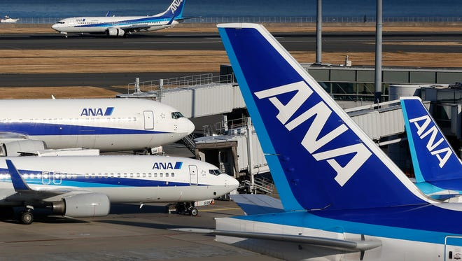 This file photo from Jan. 30, 2013, shows All Nippon Airways (ANA) planes at Tokyo's Haneda Airport.