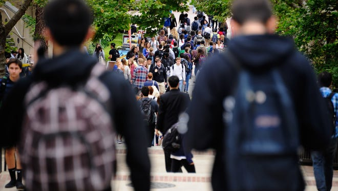 Students walk across the campus of UCLA in Los Angeles, California.