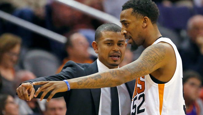 Phoenix Suns Interim head coach Earl Watson talks with guard Jordan McRae in the first  half of their loss to the Toronto Raptors on Tuesday, Feb 2, 2016 in Phoenix AZ.