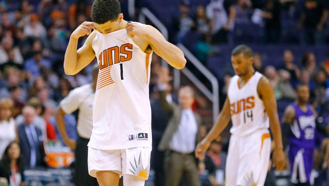 Phoenix Suns guard Devin Booker (1) walks off the court after the final buzzer, losing 105-101 against the Sacramento Kings in their NBA game Monday, April 11, 2016 in Phoenix,  Ariz. Booker missed a three point shot late in the game.