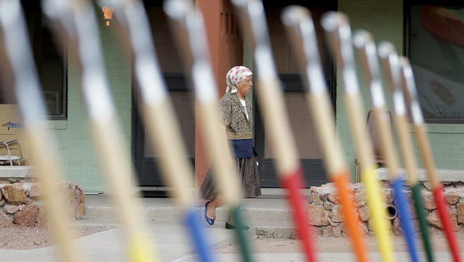 A resident walks past a row of shovels being used for a ceremonial ground breaking Tuesday at the Sherman Public Housing Complex at 4528 Blanco Ave. just east of downtown El Paso. The Sherman will be the next complex to be razed and rebuilt by the Housing Authority of the City of El Paso. The $24 million project is expected to be completed by the winter of 2017.