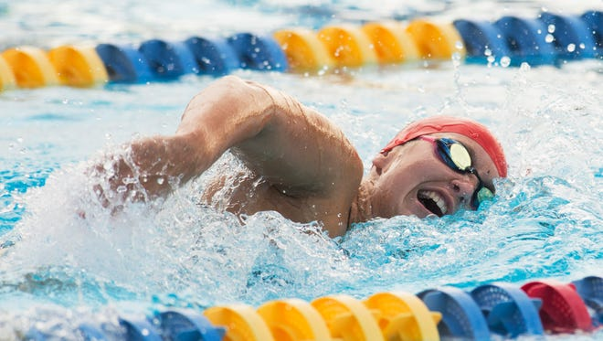 Vero Beach's Elizabeth Richardson swims the 200-meter freestyle during the high school swim/diving meet at Indian River State College on Wednesday, August 30, 2017, in Fort Pierce.