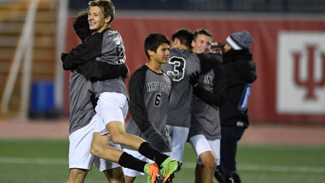 The Harrison Raiders celebrate after winning the Class 3A Boys Indiana High School Athletic Association Soccer State  Championship at Michael A. Carroll Stadium in Indianapolis Saturday, October 28, 2017.