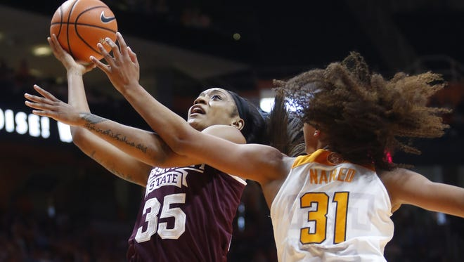Mississippi State guard Victoria Vivians (35) is defended under the basket by Tennessee guard Jaime Nared (31) in the first half of an NCAA college basketball game Sunday, Jan. 21, 2018, in Knoxville, Tenn.