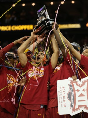 The Iowa State Cyclones celebrate after winning the Big 12 Championship title game on Saturday, March 14, 2015.