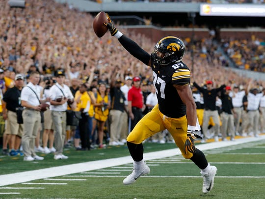 FILE - In this Sept. 15, 2018, file photo, Iowa tight end Noah Fant scores on a 5-yard touchdown pass during the first half of an NCAA college football game against Northern Iowa, in Iowa City, Iowa. Fant is a possible pick in the 2019 NFL Draft. (AP Photo/Charlie Neibergall, File)