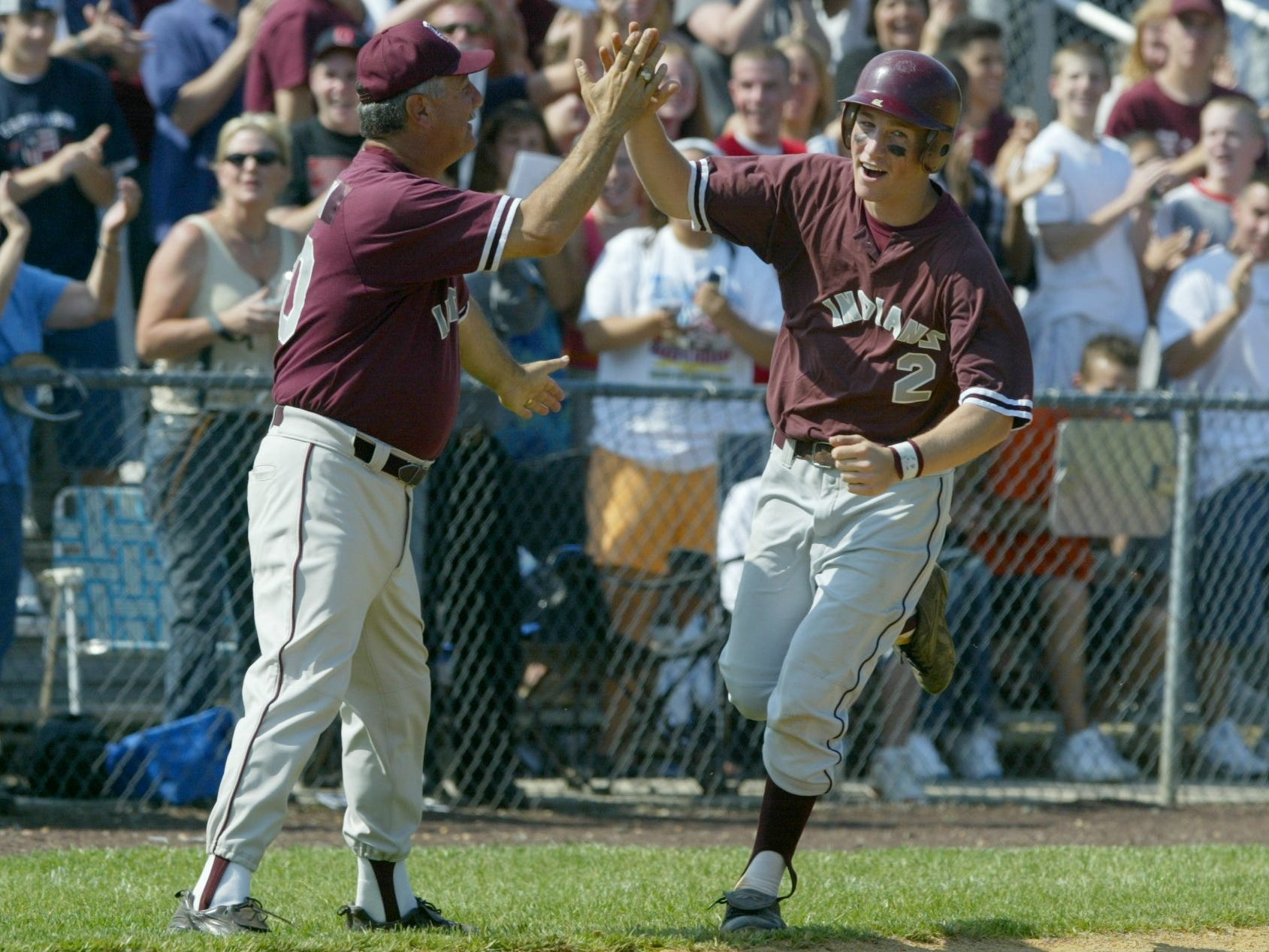 Todd Frazier celebrates with coach Ken Frank as he rounds third after ripping a home run against Cranford in 2003.