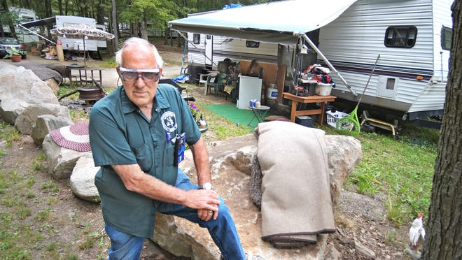 Webster Family Campground owner Michael Finamore stands in front of one of the four-season, recreational vehicles parked inside his campground in a file photo.