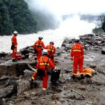 A paramilitary rescue team searches for life signs