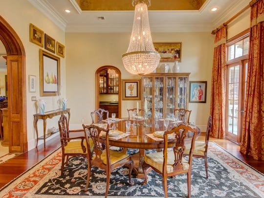The elegant dining room is large enough for any formal gathering.