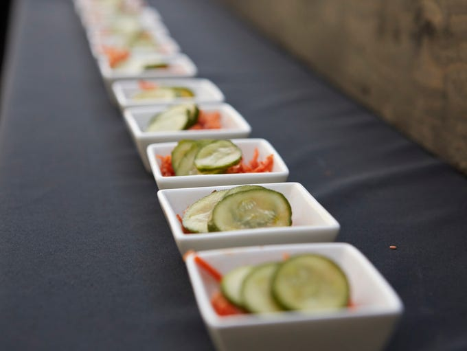 Dishes of pickles and kimchi sit ready for guests during