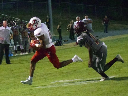 Tioga defensive back Ty'Darian Quinney (4) races past
