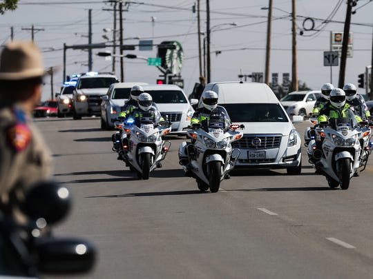 The procession with the hearse surrounding by police motorcycles lead San Angelo police Sgt. Freddy Dietz Jr. to his final resting place Thursday, Nov. 9, 2017, at Belvedere Cemetery.