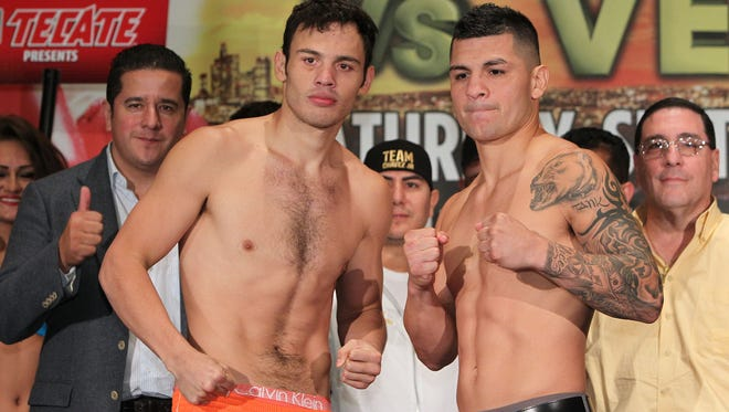 Former WBC middleweight champion Julio Cesar Chavez Jr., left, and  and No. 1 contender Bryan Vera weigh in (Chavez jr. 172.4 lbs , Vera 171.2 lbs ) Friday for their upcoming fight Saturday.