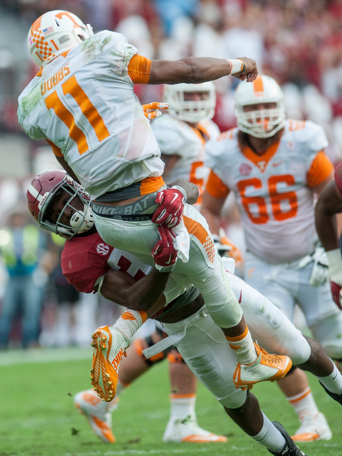 Alabama linebacker Rashaan Evans (32) tackles Tennessee quarterback Joshua Dobbs (11) as he releases the ball at Bryant-Denny Stadium in Tuscaloosa, Ala. on Saturday October 24, 2015. (Mickey Welsh / Montgomery Advertiser)