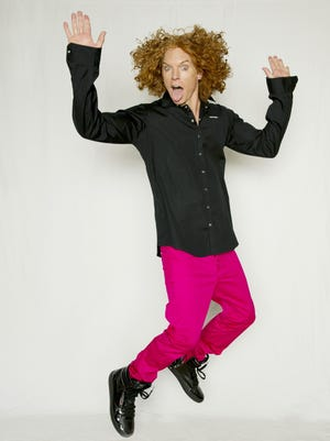 Comedian Carrot Top is known for his rock 'n' roll style of comedy. He usually has a box of props, too.