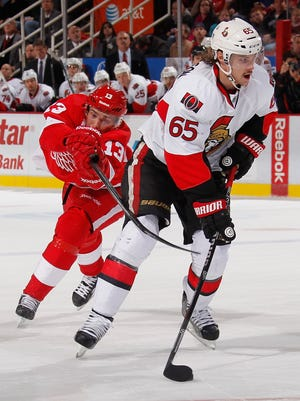 Pavel Datsyuk tries to disrupt  Erik Karlsson during the third period.