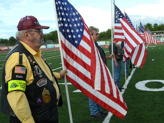Veterans stand with American flags during the Sept.