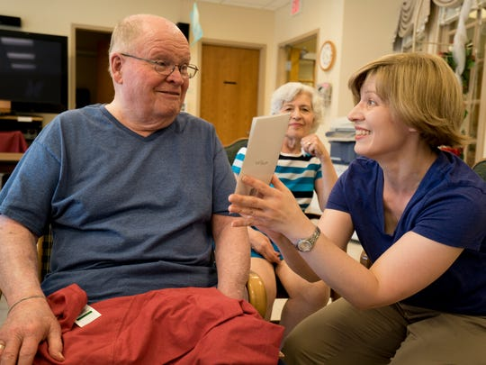 Chuck Mann, left, gets a visit from his wife, Ruth, rear, and daughter Bridget, right, on Father's Day in 2016. Ruth Mann said having her daughter, one of seven children, so involved makes it seem like they are a team.
