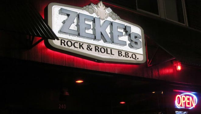 Zeke's Rock & Roll BBQ's sign, rendered in steel letters, marks the front of the restaurant at 240 W. Nine Mile in Ferndale.