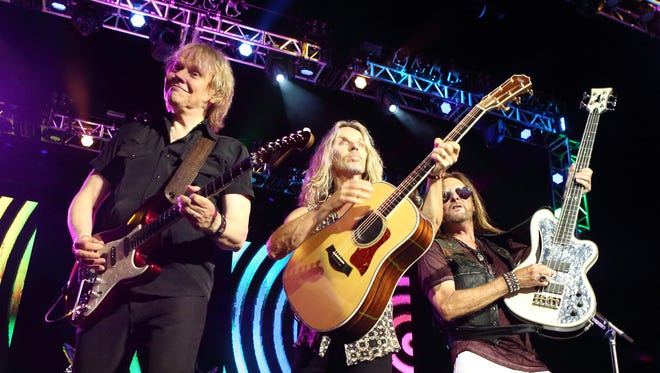 James Young, from left, Tommy Shaw and Ricky Phillips of the band Styx perform during the 'Soundtrack of Summer Tour 2014' at the Susquehanna Bank Center on July 3, 2014, in Camden, New Jersey.