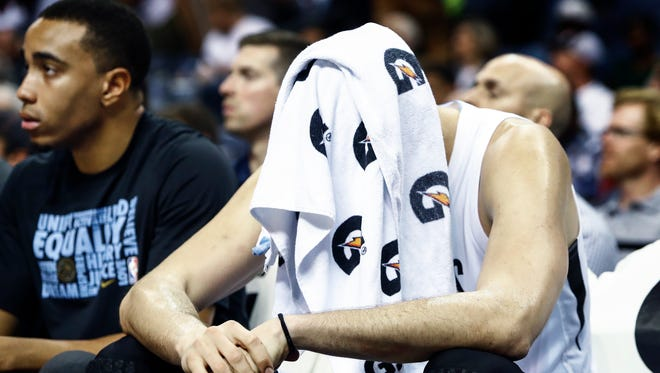 Memphis Grizzlies center Marc Gasol covers his head on the bench during 112-89 loss to the Cleveland Cavaliers at the FedExForum in Memphis, Tenn., Friday, February 23, 2018.