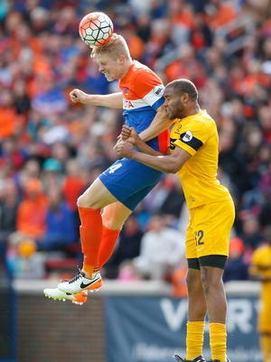 FC Cincinnati defender Harrison Delbridge (4) goes up for a header in the second half during the USL soccer game between the Pittsburgh Riverhounds and FC Cincinnati, Saturday, May 14, 2016, at Nippert Stadium in Cincinnati.