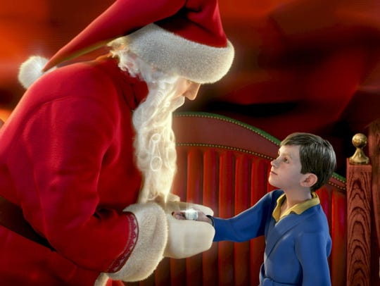 "A young boy meets Santa in this scene from ""The Polar Express,"" starring Tom Hanks in several voiced roles."