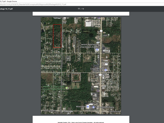 The property outlined in red is a 12.83 acre parcel