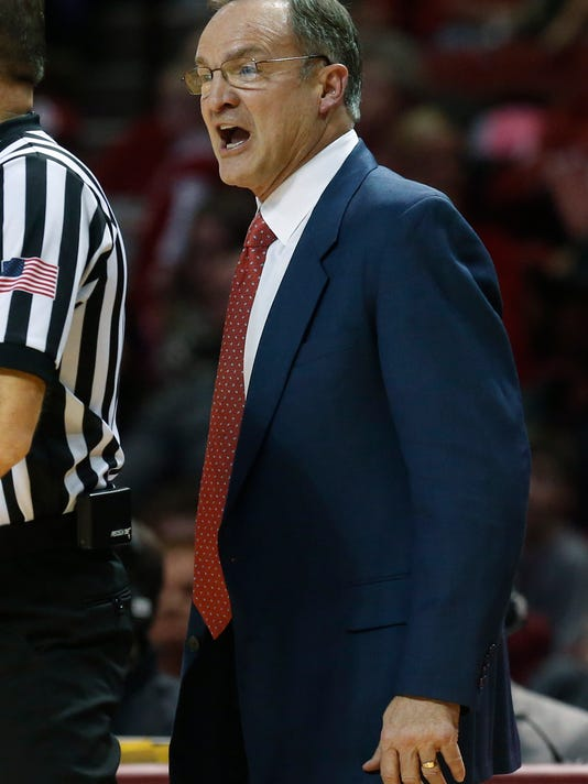 Oklahoma head coach Lon Kruger shouts to an official in the first half of an NCAA college basketball game against Kansas State in Norman, Okla., Saturday, Jan. 10, 2015. (AP Photo/Sue Ogrocki)