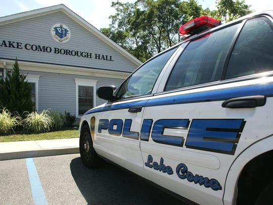 A police cruiser parked in front of Lake Como Borough Hall.