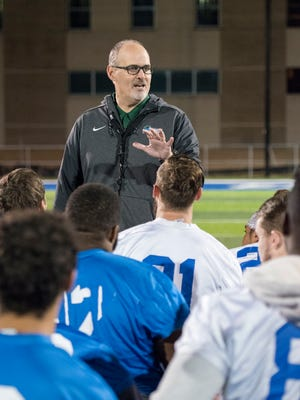 Head coach Pete Shinnick talks with his players at the conclusion of football practice at the University of West Florida in Pensacola on Monday, December 11, 2017.