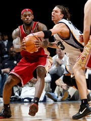 Cleveland Cavaliers' LeBron James (23) grabs a passwhile defended by Memphis Grizzlies' Mike Miller (33) in the second half of an NBA basketball game Tuesday, Jan. 15, 2008, in Memphis, Tenn. James scored a season-high 51 points in the Cavaliers' 132-124 overtime victory. (AP Photo/Nikki Boertman)
