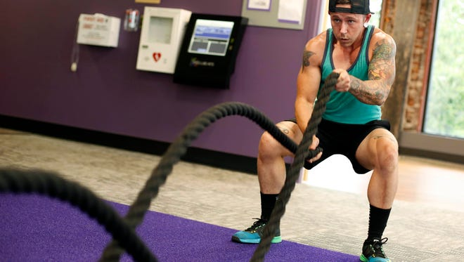 Ricky Riis works out Saturday, July 30, 2016, at Anytime Fitness in downtown Des Moines. Riis said working out was the one thing he knew he had control over when he felt the rest of his life was out of control as he transitioned from a female to a male.