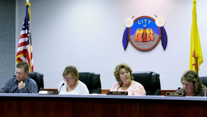 Aztec City Commissioners Austin Randall, left, Sally Burbridge, Sherri Sipe and Sheri Rogers discuss an issue on March 8 at Aztec City Hall.