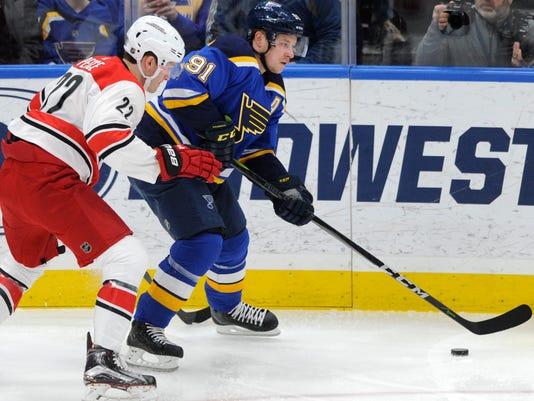 St. Louis Blues' Vladimir Tarasenko (91), of Russia, skates by Carolina Hurricanes' Brett Pesce (22) during the first period of an NHL hockey game Saturday, Dec. 30, 2017, in St. Louis. (AP Photo/Bill Boyce)