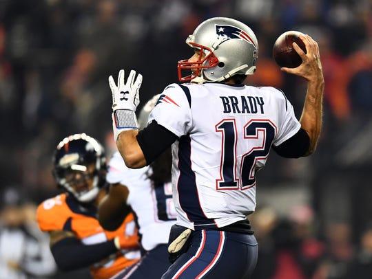 New England Patriots quarterback Tom Brady (12) prepares