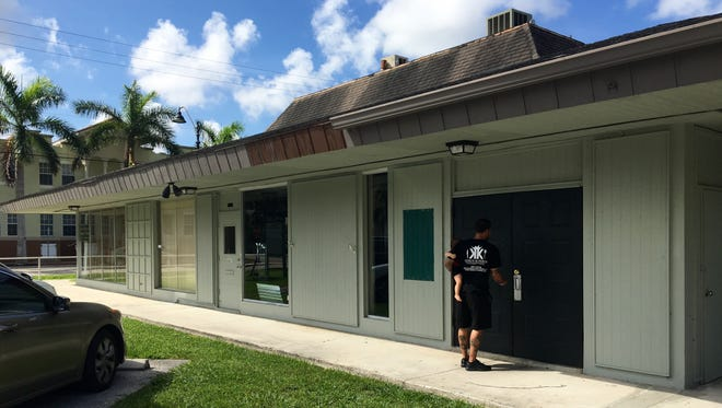Edwin Cruz locks the door at his newest King's Kitchen location. The restaurant plans to open in the old Sub & Pub space near downtown Fort Myers in August.