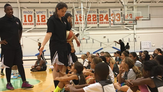 Shannon O'Connor, one of the coaches at the New York Liberty's summer basketball camp, interacts with campers at the MSG Training Facility in Tarrytown. July 28, 2016.