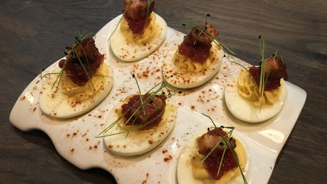 The bacon & eggs, deviled eggs, tomato jam and candied bacon, are on the Public House menu for $7.